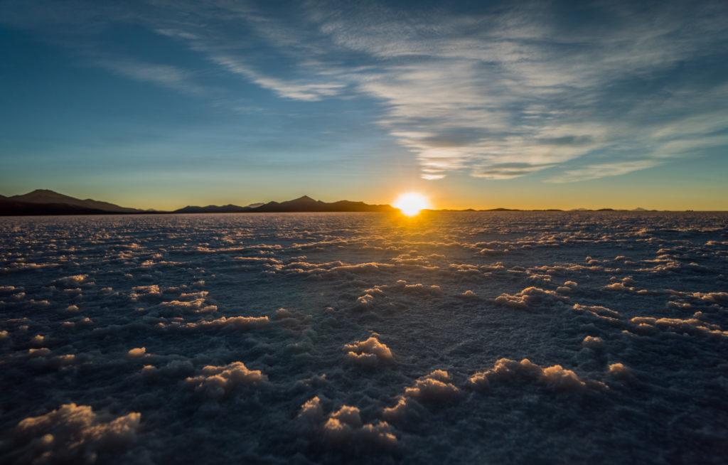 Salt flat sunset seen while adventure coaching